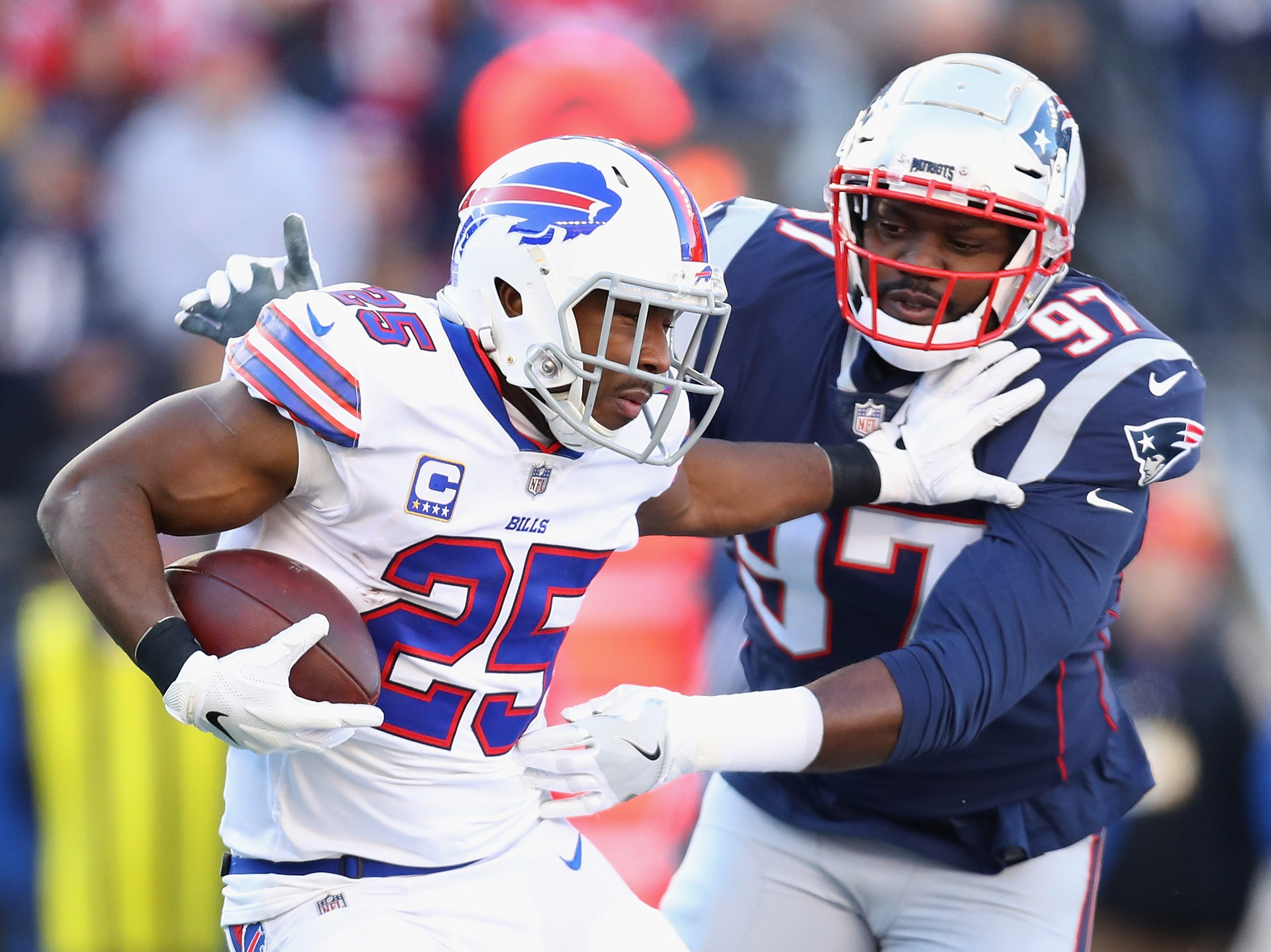 FOXBOROUGH, MA - DECEMBER 23:  Ufomba Kamalu #97 of the New England Patriots attempts to tackle LeSean McCoy #25 of the Buffalo Bills during the first half at Gillette Stadium on December 23, 2018 in Foxborough, Massachusetts.  (Photo by Maddie Meyer/Getty Images)