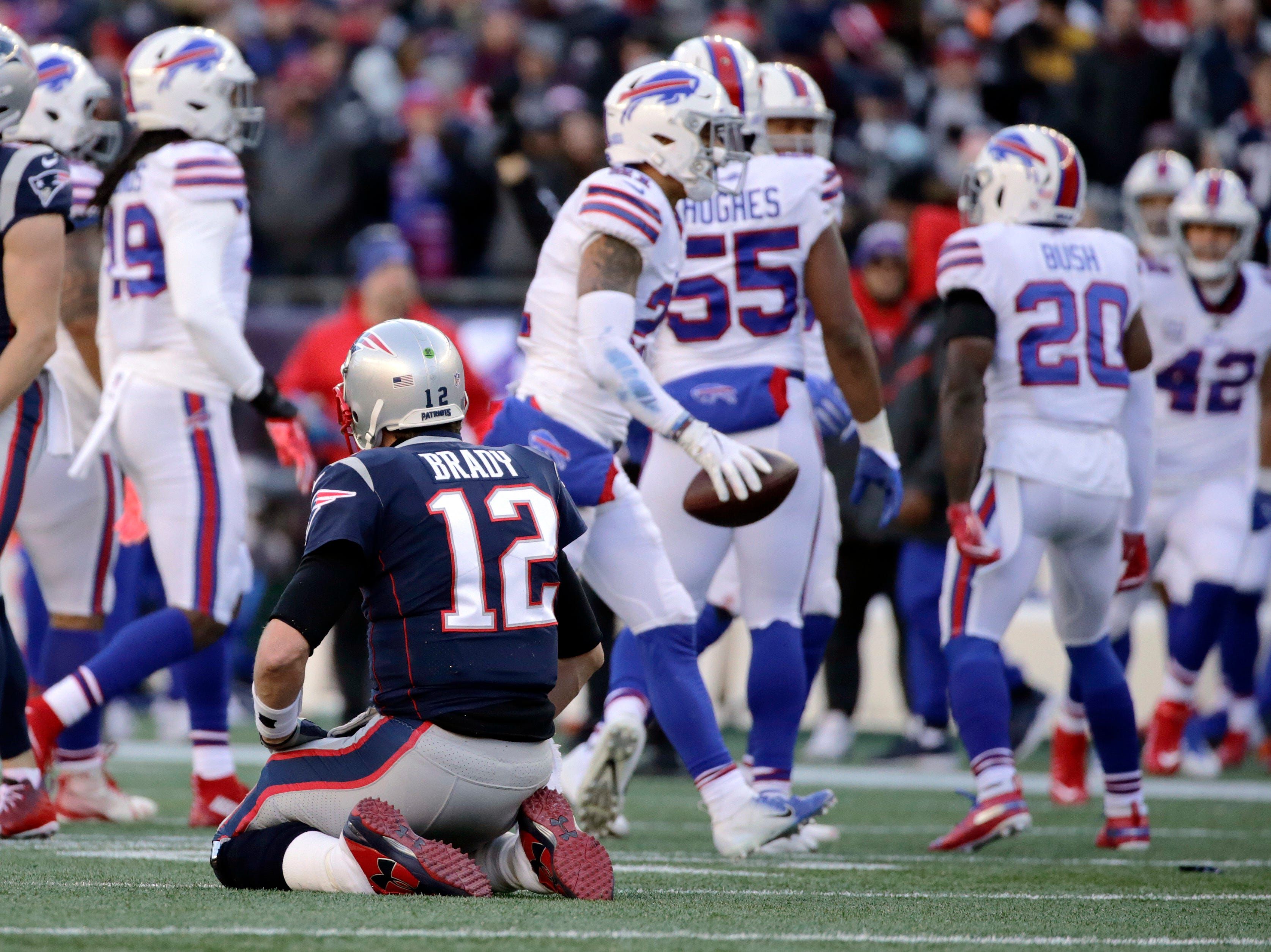 Buffalo Bills linebacker Lorenzo Alexander carries the ball after intercepting a pass by New England Patriots quarterback Tom Brady (12) during the first half of an NFL football game, Sunday, Dec. 23, 2018, in Foxborough, Mass. (AP Photo/Elise Amendola)