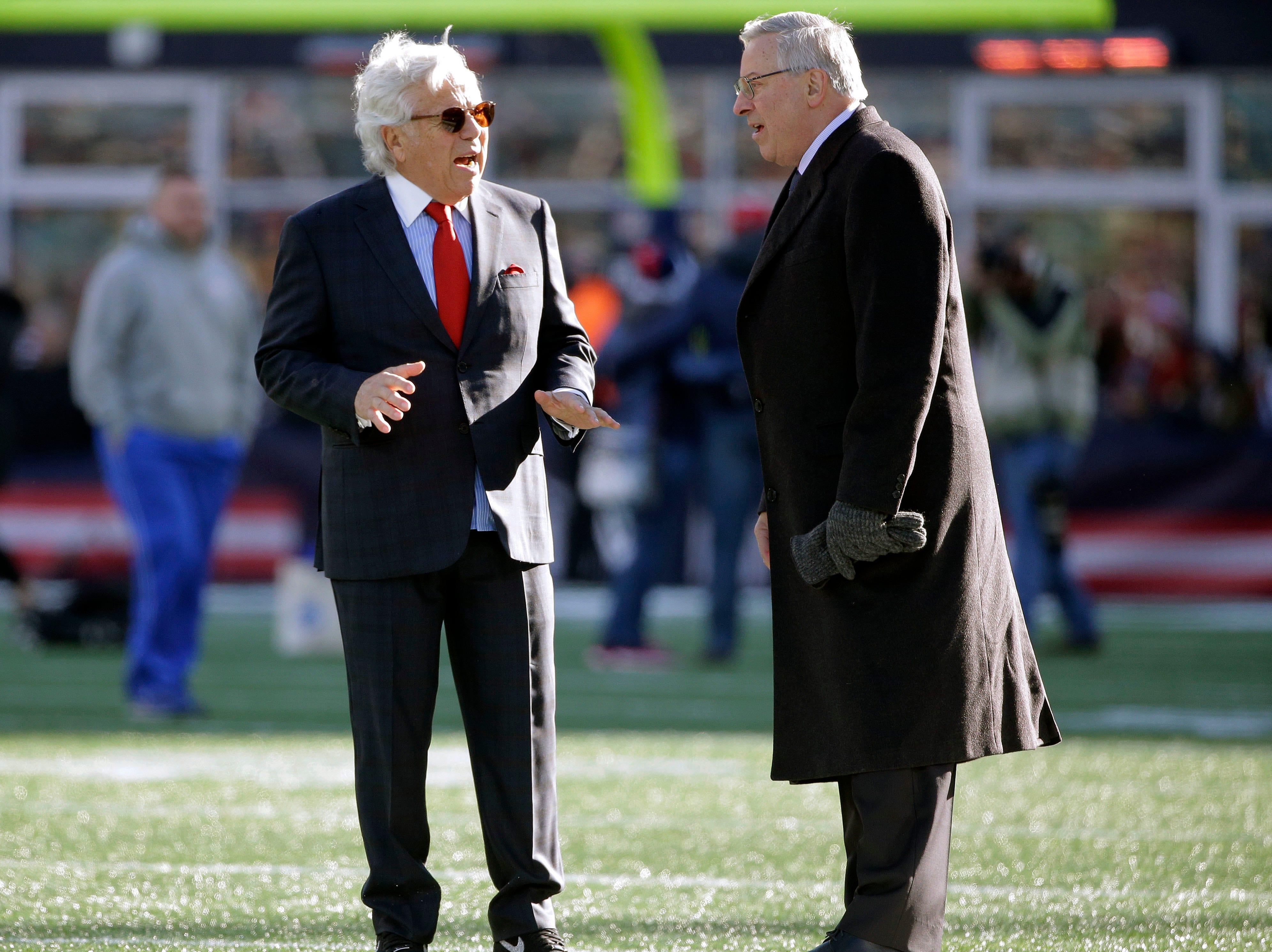 New England Patriots owner Robert Kraft, left, speaks to Buffalo Bills owner Terry Pegula before an NFL football game, Sunday, Dec. 23, 2018, in Foxborough, Mass. (AP Photo/Steven Senne)