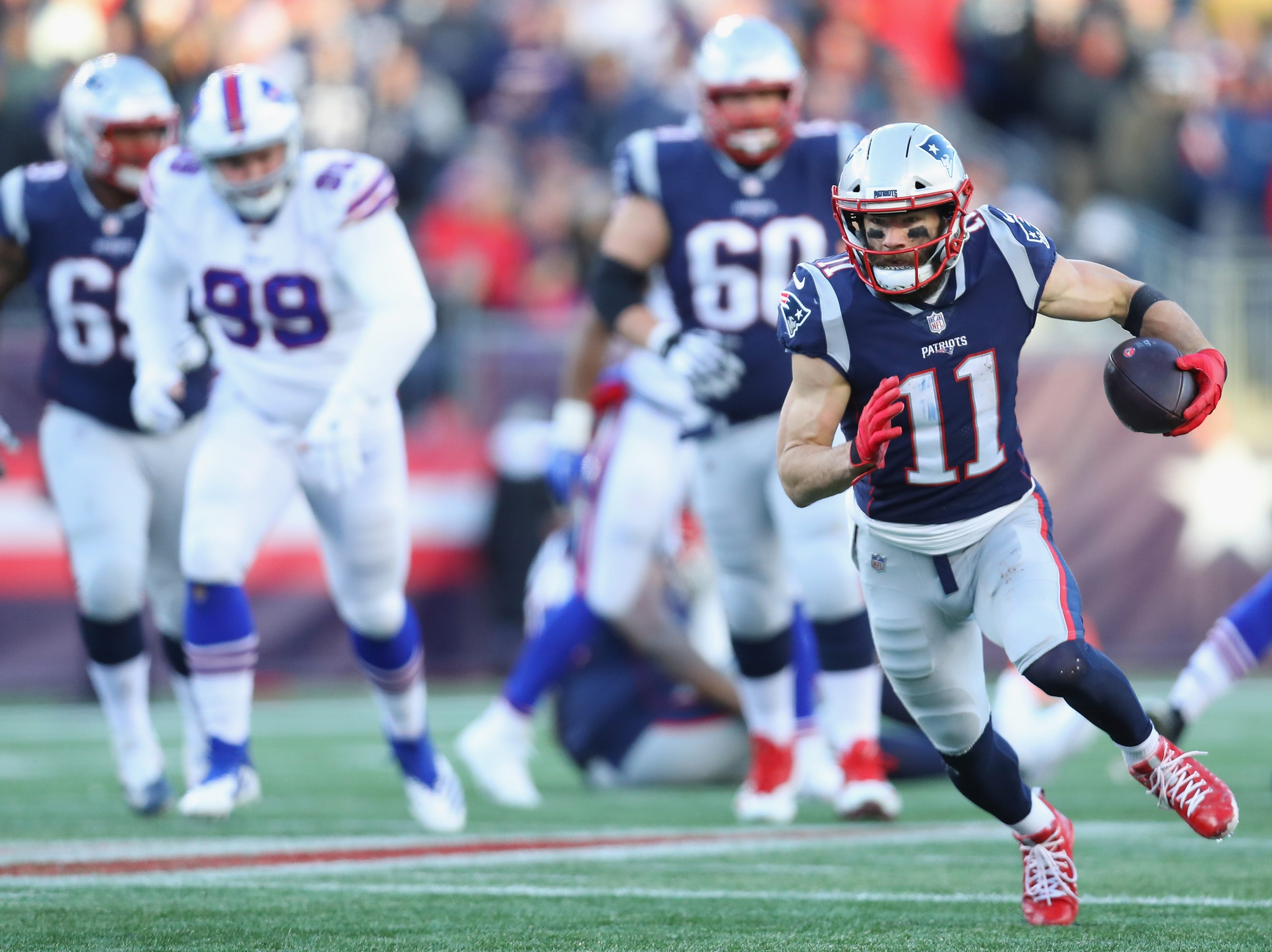 FOXBOROUGH, MA - DECEMBER 23:  Julian Edelman #11 of the New England Patriots runs with the ball during the second half against the Buffalo Bills at Gillette Stadium on December 23, 2018 in Foxborough, Massachusetts.  (Photo by Maddie Meyer/Getty Images)
