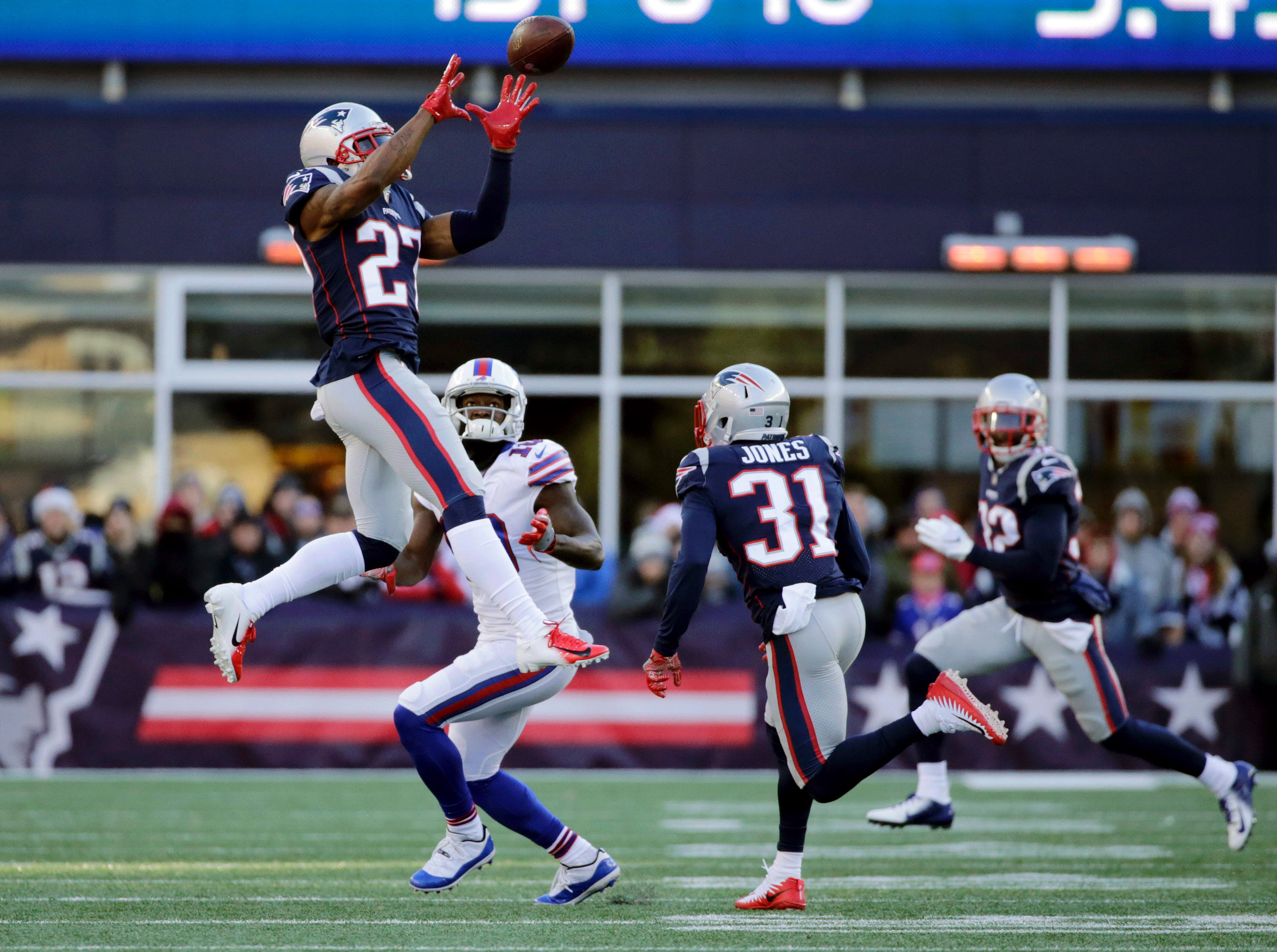 New England Patriots defensive back J.C. Jackson (27) intercepts a pass intended for Buffalo Bills wide receiver Deonte Thompson (10) during the first half of an NFL football game, Sunday, Dec. 23, 2018, in Foxborough, Mass. (AP Photo/Elise Amendola)
