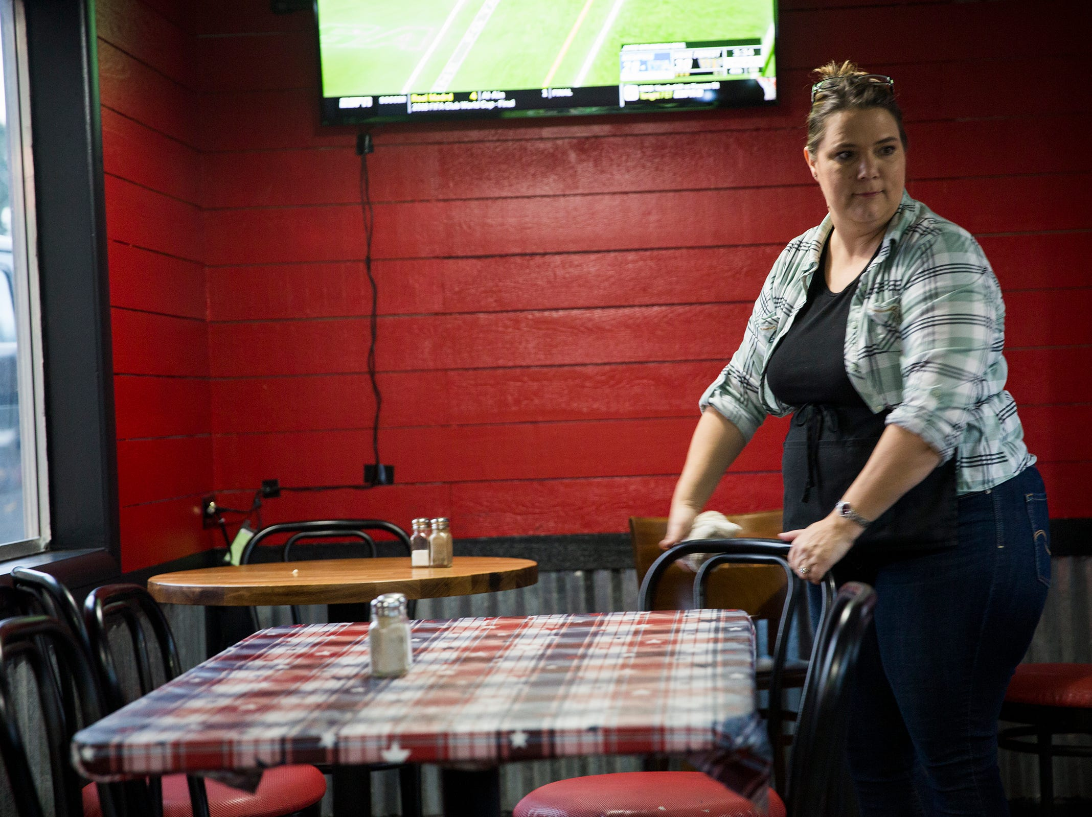 Julie Lorraine wipes down tables at her restaurant Squatchy's BBQ in Stayton on Saturday, Dec. 22, 2018.