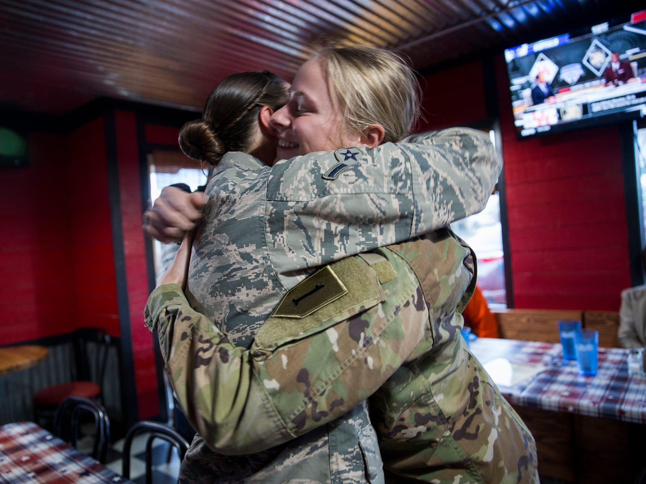 Courtney Lorraine hugs her older sister Kelsey Lorraine at their family restaurant Squatchy's BBQ in Stayton on Saturday, Dec. 22, 2018.