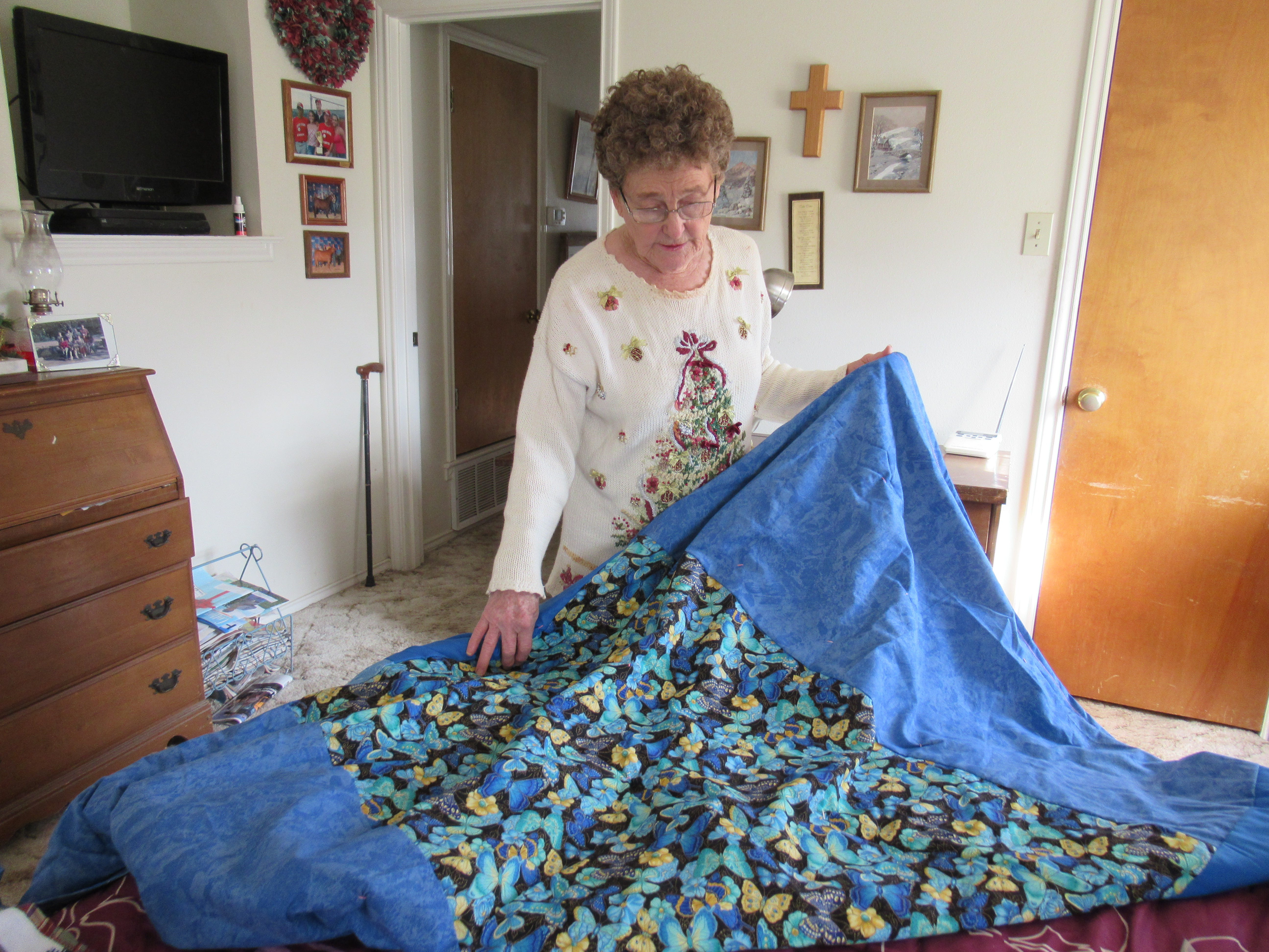 La Verne Redman describes how she color coordinated the different material pieces of her quilt, Monday, Dec. 18, 2018 at her home in Miles, Texas.