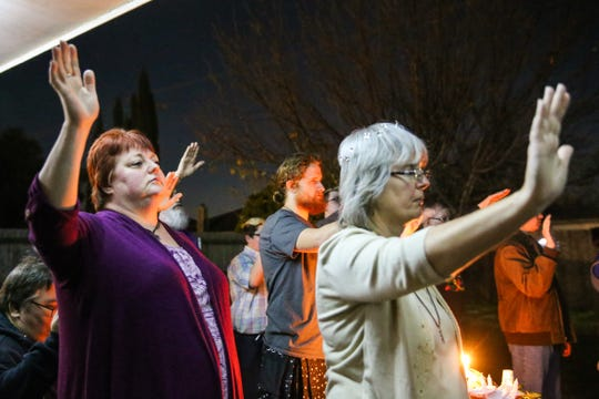 Dorri Jowers and Pam Krumwiede participate in the solstice ritual Saturday, Dec. 22, 2018, in San Angelo.