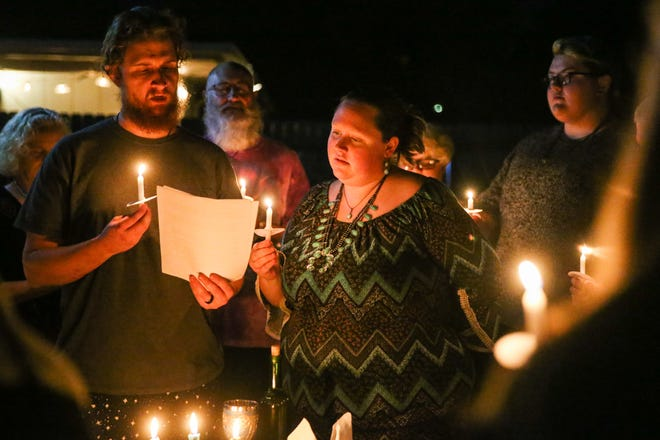 Ethan Everett and Caitlin Everett lead the solstice ritual Saturday, Dec. 22, 2018, in San Angelo.