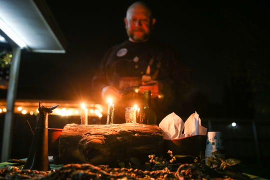 Darren Krumwiede prepares the alter for the solstice ritual Saturday, Dec. 22, 2018, in San Angelo.