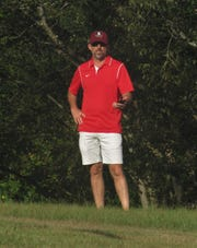Leon cross country coach Andrew Wills times his runners during the Aucilla Christian Stampede this fall.