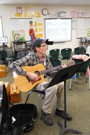 Gary Lyda is a guitarist and a member of the school's maintenance staff.