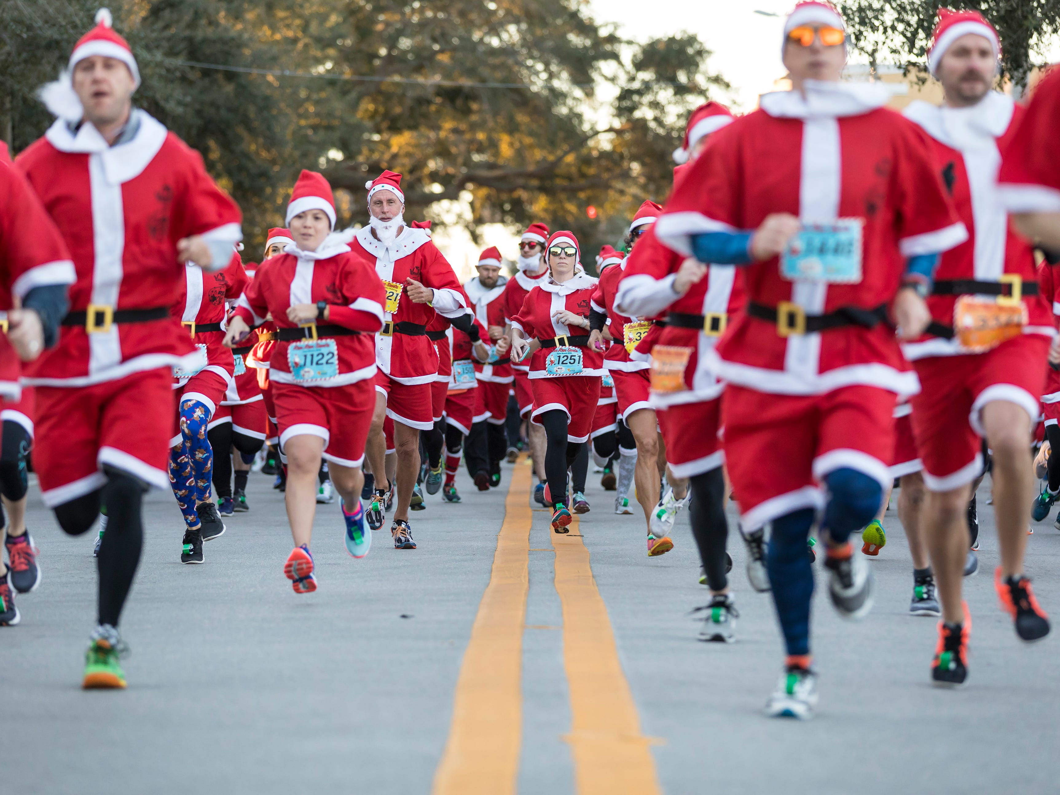 "Hundreds of runners donned Santa Claus outfits Sunday, Dec. 23, 2018, and took part in the second year of the Run Run Santa one-mile race through downtown Vero Beach. ""This actually started in Viera 3 years ago,"" said Brittany Streufert, race director. ""I grew up in Vero Beach, and we had such big success in Viera that we wanted to try it in Vero Beach, too. We had over 400 registered (last year). This year we had over 600."" Money raised at the event was collected by the Power of Pizza Charities and will go to benefit Indian River Healthy Start Coalition's Babies and Beyond."