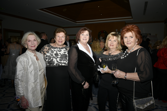 "Carole Brown, left, Linda Teetz, Debbie Lewis, Rita Lewis and Dede Layer at Hibiscus Children's Center's ""Wonderland"" gala benefit for Hibiscus Village."