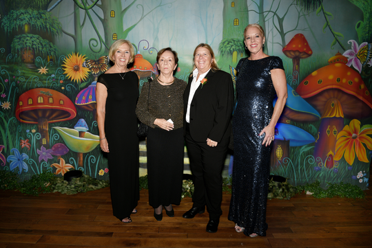 """Pat Rado, left, Joan Frazier, Leanne Kelleher and Claudia Arens of The Tides at Hibiscus Children's Center's """"Wonderland"""" gala benefit for Hibiscus Village."""