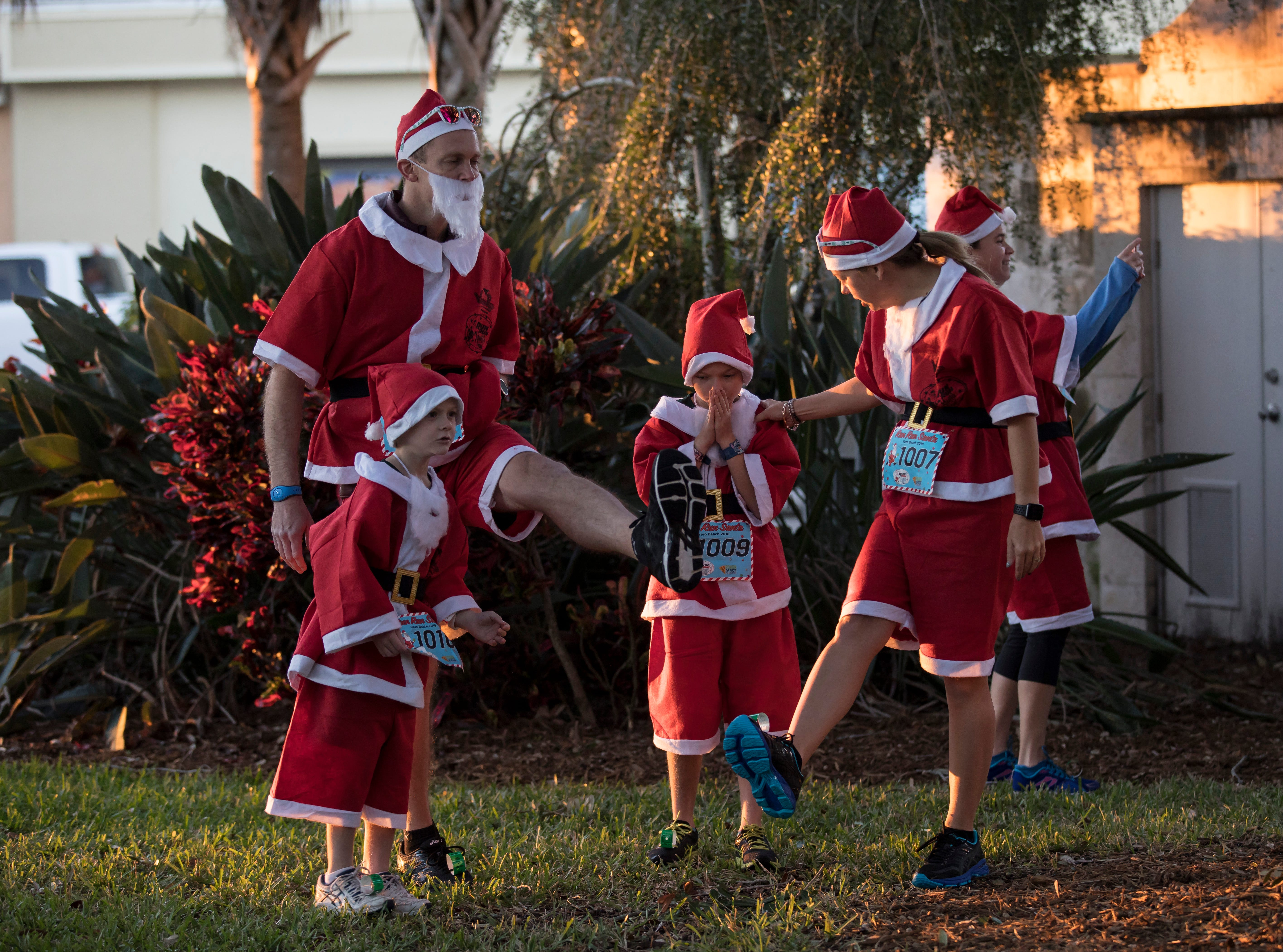 More than 600 racers competed in the Run Run Santa one-mile race Sunday, Dec. 23, 2018, through downtown Vero Beach.