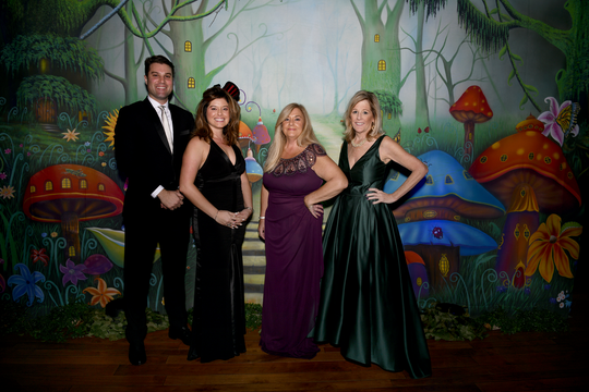 """""""Wonderland"""" gala MC's Beckett Horner and Anna Valencia Tillery, left, with chairs Rosemary Smith and Petra King at The Moorings Yacht and Country Club in Vero Beach on Dec. 8."""