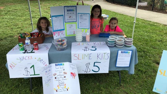 Ella and Brady Crall, ages 8 and 11, made slime to sell and also offered make-your-own slime kits. In the kit, the customer gets a container of clear glue, an activator and add-ons of glitter, paint or foam. Each slime purchase came with a holiday gift bag for easy gift giving.