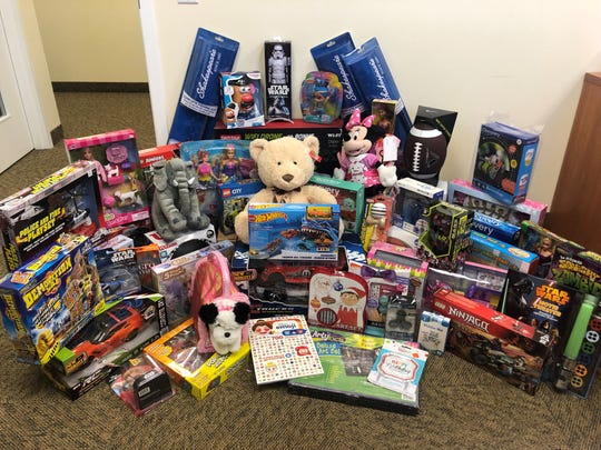 Golfers who participated in the Santa Claus Open Golf Tournament at the Stuart Yacht and Country Club donated these toys to Big Brothers Big Sisters of Palm Beach and Martin Counties.