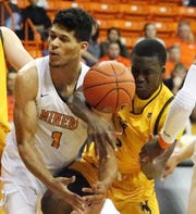 UTEP's Paul Thomas fights for the ball with A.J. Banks of Wyoming on Saturday, Dec. 22, 2018, in the Don Haskins Center.