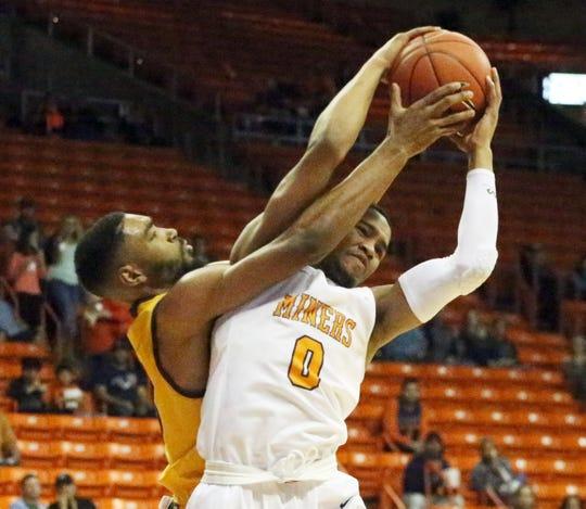 UTEP freshman guard Nigel Hawkins beats Jordan Naughton of Wyoming to a rebound Saturday, Dec. 22, 2018, in the Don Haskins Center.