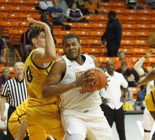 UTEP's Efe Odigie works his way to the basket against Wyoming.