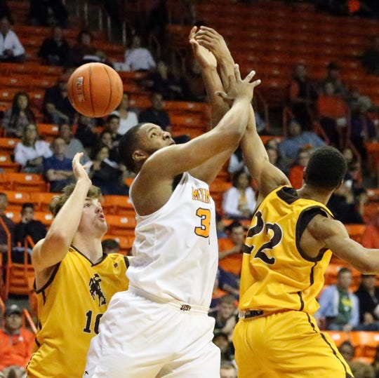 UTEP freshman forward Efe Odigie goes after an offensive rebound against Brandon Porter, 22, and Hunter Thompson of Wyoming on Saturday, Dec. 22, 2018.