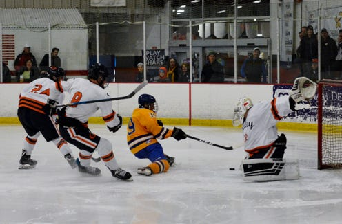 Greeley netminder Arye Wolberg makes the stop against Mahopac's Brian O'Shea.