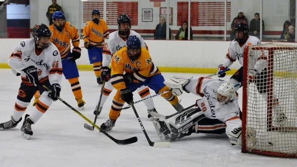 Brian O'Shea gets Mahopac within a goal, 5-4, during the third period of Saturday's loss to Greeley.