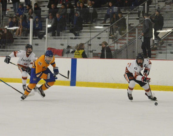 Greeley's Ryan Renzulli (24) speeds in with the puck during the second period of the Quakers win over Mahopac.