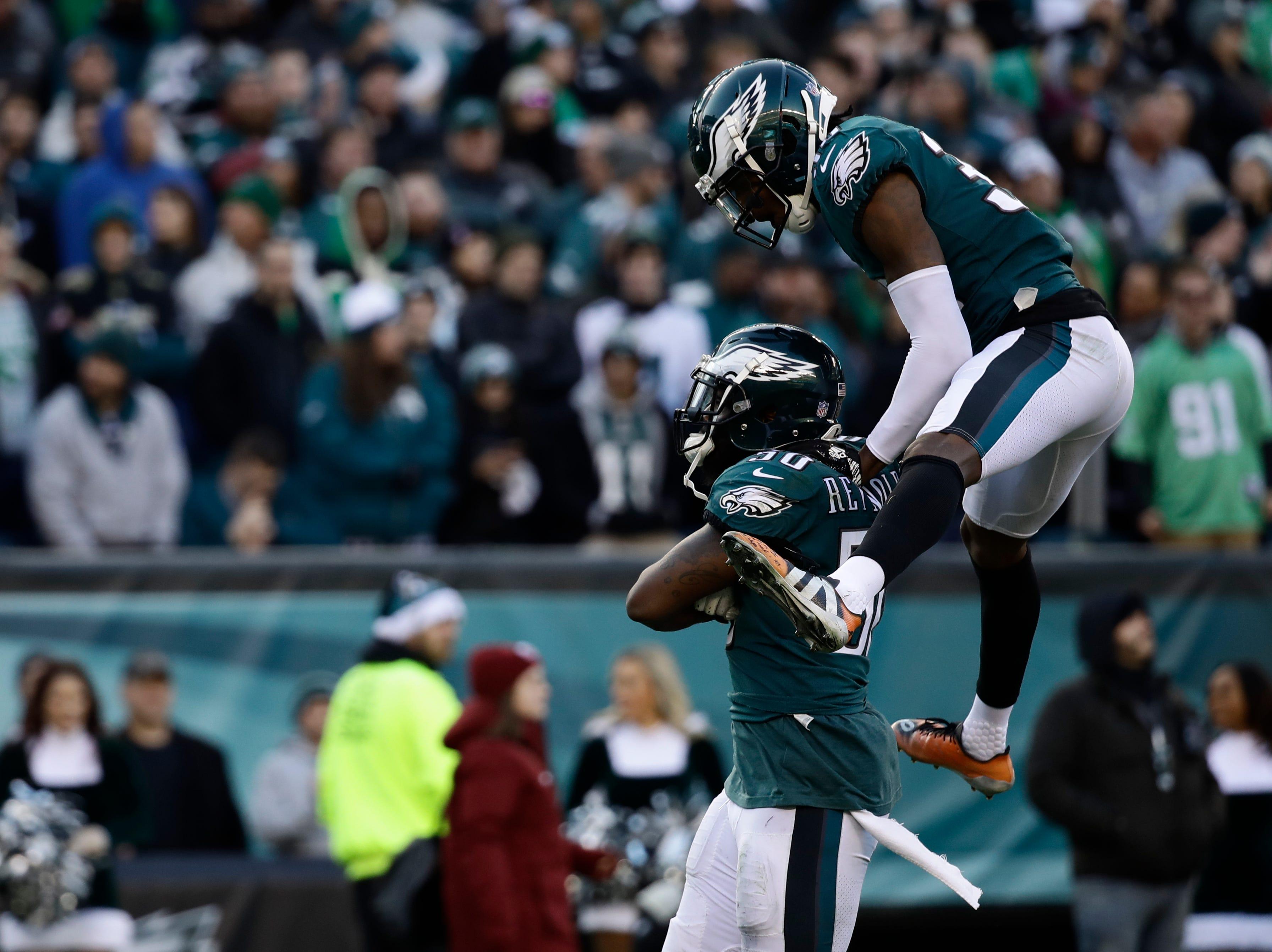 Philadelphia Eagles' LaRoy Reynolds, left, and Deiondre' Hall celebrate during the second half of an NFL football game against the Houston Texans, Sunday, Dec. 23, 2018, in Philadelphia. (AP Photo/Matt Rourke)