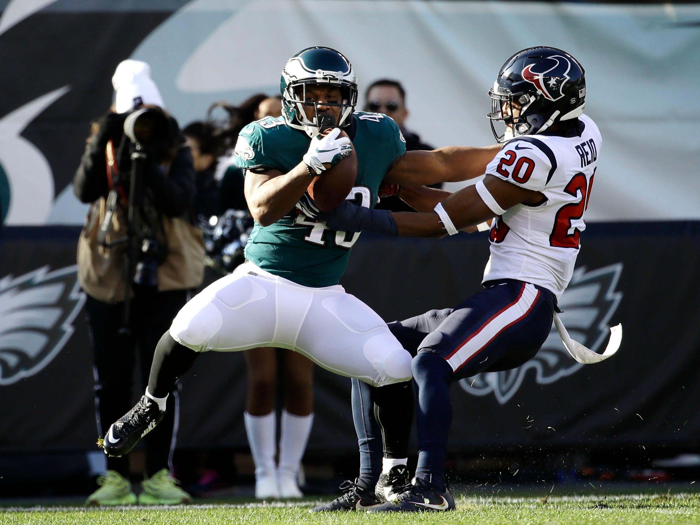 Philadelphia Eagles' Darren Sproles, left, breaks free from Houston Texans' Justin Reid on a touchdown catch during the first half of an NFL football game, Sunday, Dec. 23, 2018, in Philadelphia. (AP Photo/Matt Rourke)