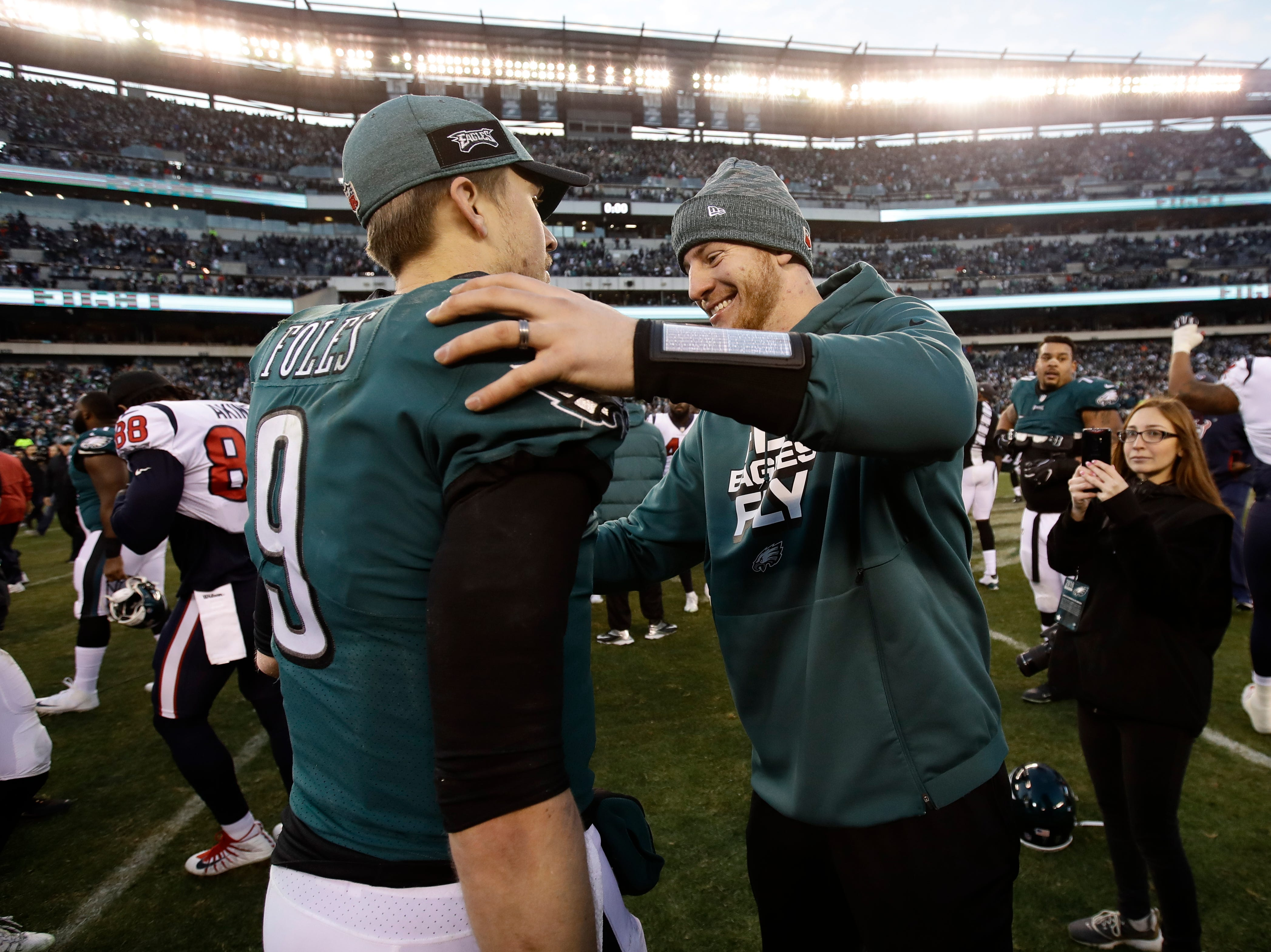 Philadelphia Eagles' Nick Foles, left, and Carson Wentz celebrate after an NFL football game against the Houston Texans, Sunday, Dec. 23, 2018, in Philadelphia. Philadelphia won 32-30. (AP Photo/Matt Rourke)
