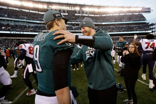 Philadelphia Eagles' Nick Foles, left, and Carson Wentz celebrate after an NFL football game against the Houston Texans, Sunday, Dec. 23, 2018, in Philadelphia. Philadelphia won 32-30. (AP Photo/Matt Rourke)