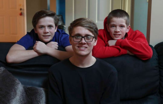 Ryan Pirrung, with younger brothers Tyler, left, and Dylan, is halfway through his senior year of high school at Conrad Schools of Science and has his sights set on continuing his swimming career at Cornell. He's in the midst of his last winter break as a high school student.