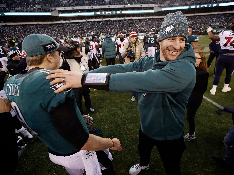 Philadelphia Eagles' Carson Wentz, right, and Nick Foles celebrate after an NFL football game against the Houston Texans, Sunday, Dec. 23, 2018, in Philadelphia. Philadelphia won 32-30. (AP Photo/Matt Rourke)