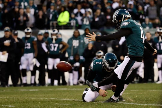 Philadelphia Eagles' Jake Elliott (4) kicks the game-winning field goal from the hold of Cameron Johnston (1) during an NFL football game against the Houston Texans, Sunday, Dec. 23, 2018, in Philadelphia. Philadelphia won 32-30. (AP Photo/Matt Rourke)