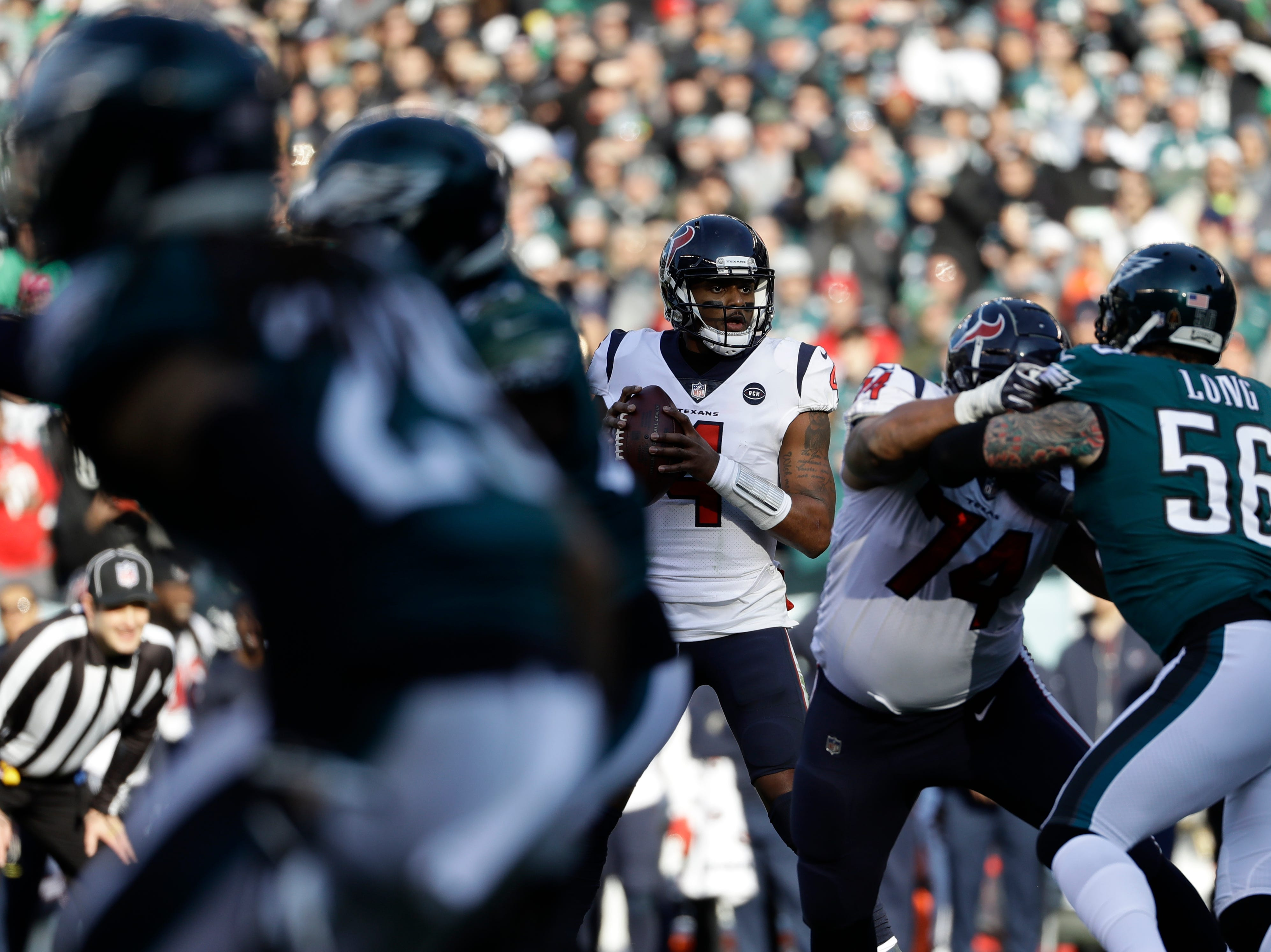 Houston Texans' Deshaun Watson in action during the first half of an NFL football game against the Philadelphia Eagles, Sunday, Dec. 23, 2018, in Philadelphia. (AP Photo/Michael Perez)