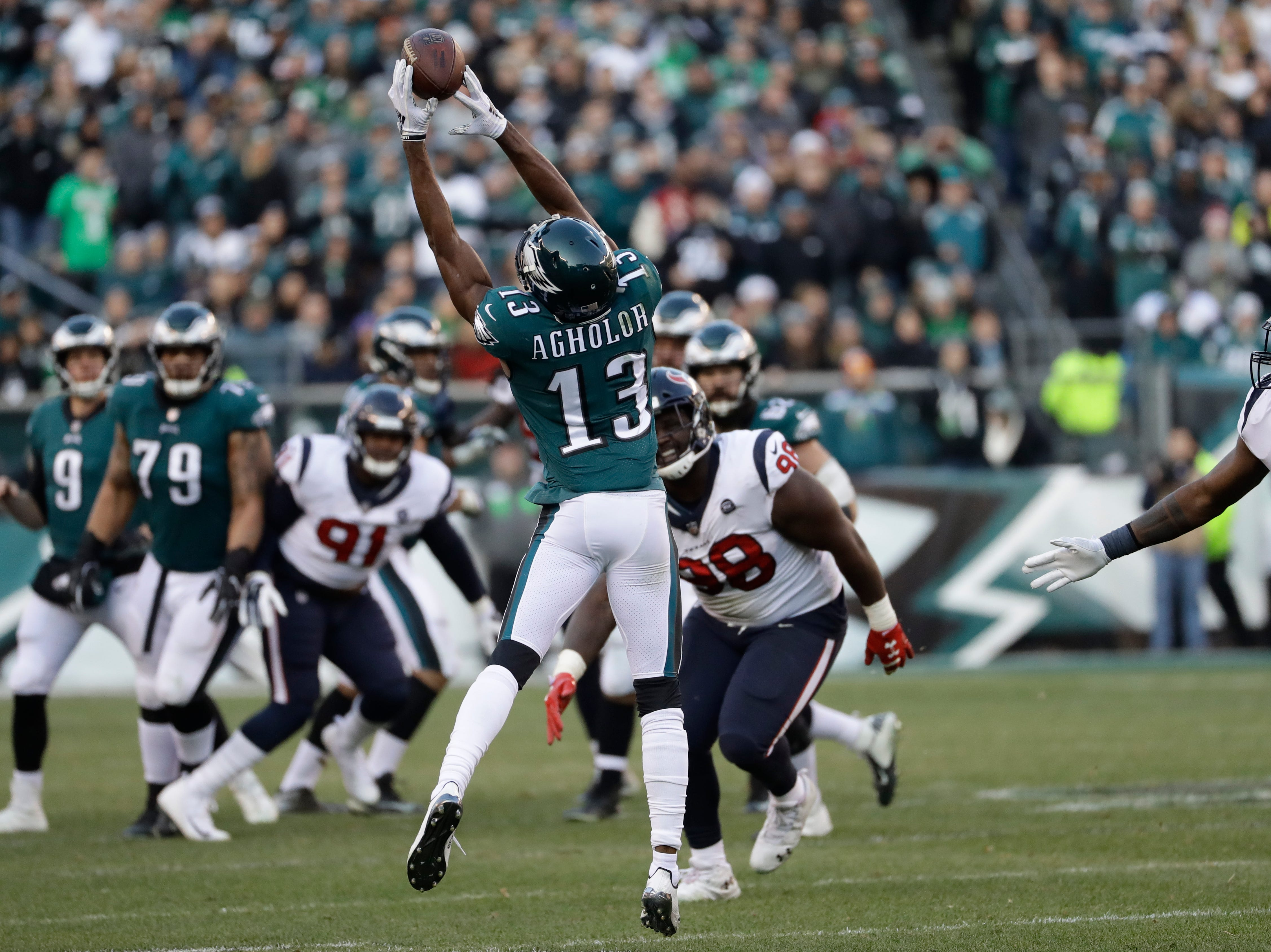Philadelphia Eagles' Nelson Agholor catches a pass during the second half of an NFL football game against the Houston Texans, Sunday, Dec. 23, 2018, in Philadelphia. (AP Photo/Michael Perez)