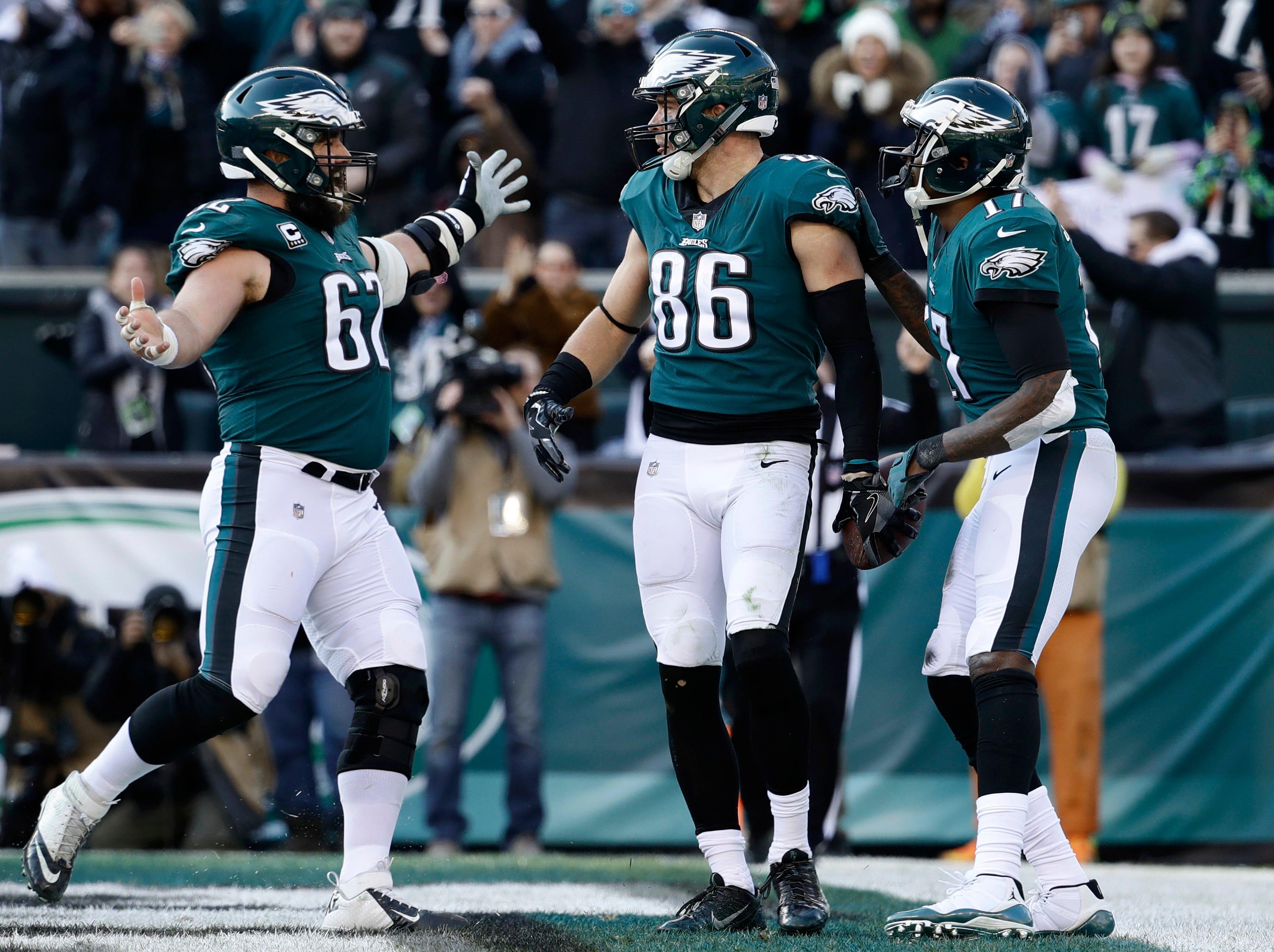 Philadelphia Eagles' Zach Ertz (86) celebrates with Jason Kelce (62) and Alshon Jeffery (17) after a touchdown during the first half of an NFL football game against the Houston Texans, Sunday, Dec. 23, 2018, in Philadelphia. (AP Photo/Matt Rourke)