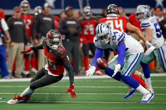 Tampa Bay Buccaneers wide receiver Bobo Wilson (85) watches as Dallas Cowboys defensive end Randy Gregory (94) recovers a fumble in the second half of an NFL football game in Arlington, Texas, Sunday, Dec. 23, 2018. (AP Photo/Ron Jenkins)