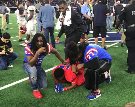 Duncanville players console junior Marquelan Crowell after the Panthers lost on a Hail Mary.