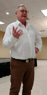 Dennis Hoiberg, a consultant for farming communities around the world, talks to a group in Sauk Center, Minn., on Friday, Dec. 7, 2018, for the Farming in Tough Times conference. (Nora Hertel/The St. Cloud Times via AP)
