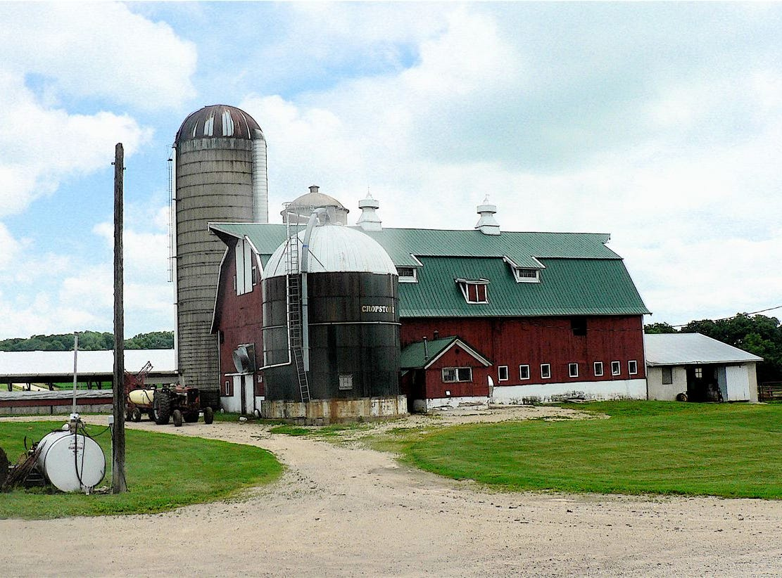 Empty dairy barns dot the Wisconsin rural landscape.