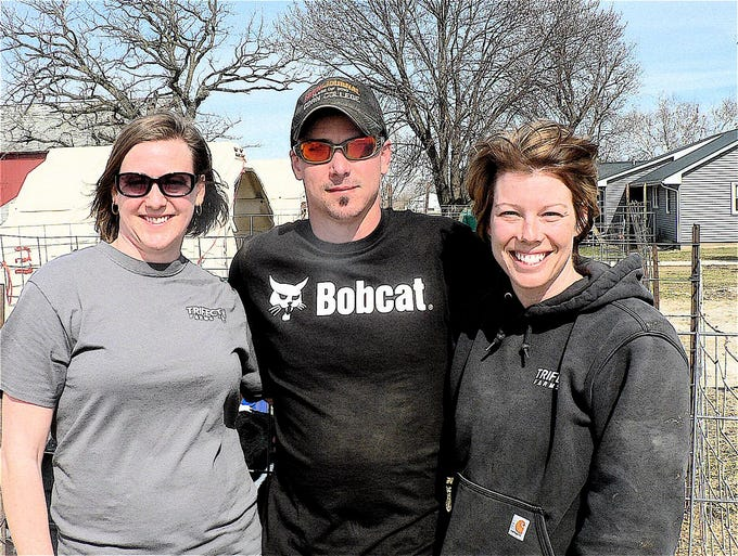 The Schultz siblings (from left) Kari Schultz Gribble. Nick and Katy Schultz  own Trifecta farm at Fox Lake milking 400 cows and farming 2000 acres.