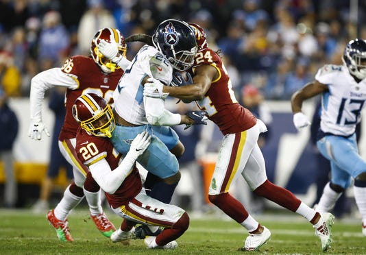 f76c8b470fa Redskins' Josh Norman throws helmet at Titans' Taylor Lewan in clash