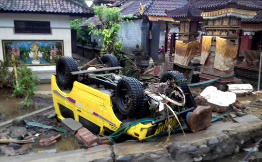 A handout photo made available by the Indonesia's national disaster management (BNPB) shows a ruined car that was rolled over after a tsunami hit Sunda Strait, in Anyer, Banten, Indonesia, 23 December 2018. According to BNPB, at least 43 people dead and 584 others have been injured.