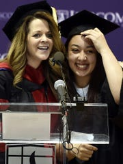 Inmate Cyntoia Brown, right, of the Tennessee Prison for Women gets a hug from a Lipscomb University faculty member after delivering a commencement address Dec. 18, 2015, before she received associate degrees from Lipscomb University in Nashville, Tennessee.