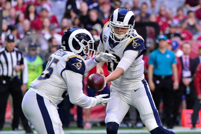 Running back C.J. Anderson, left, stepped into Todd Gurley's shoes and looked remarkably like the player who rushed for over 1,000 yards last season for the Denver Broncos.