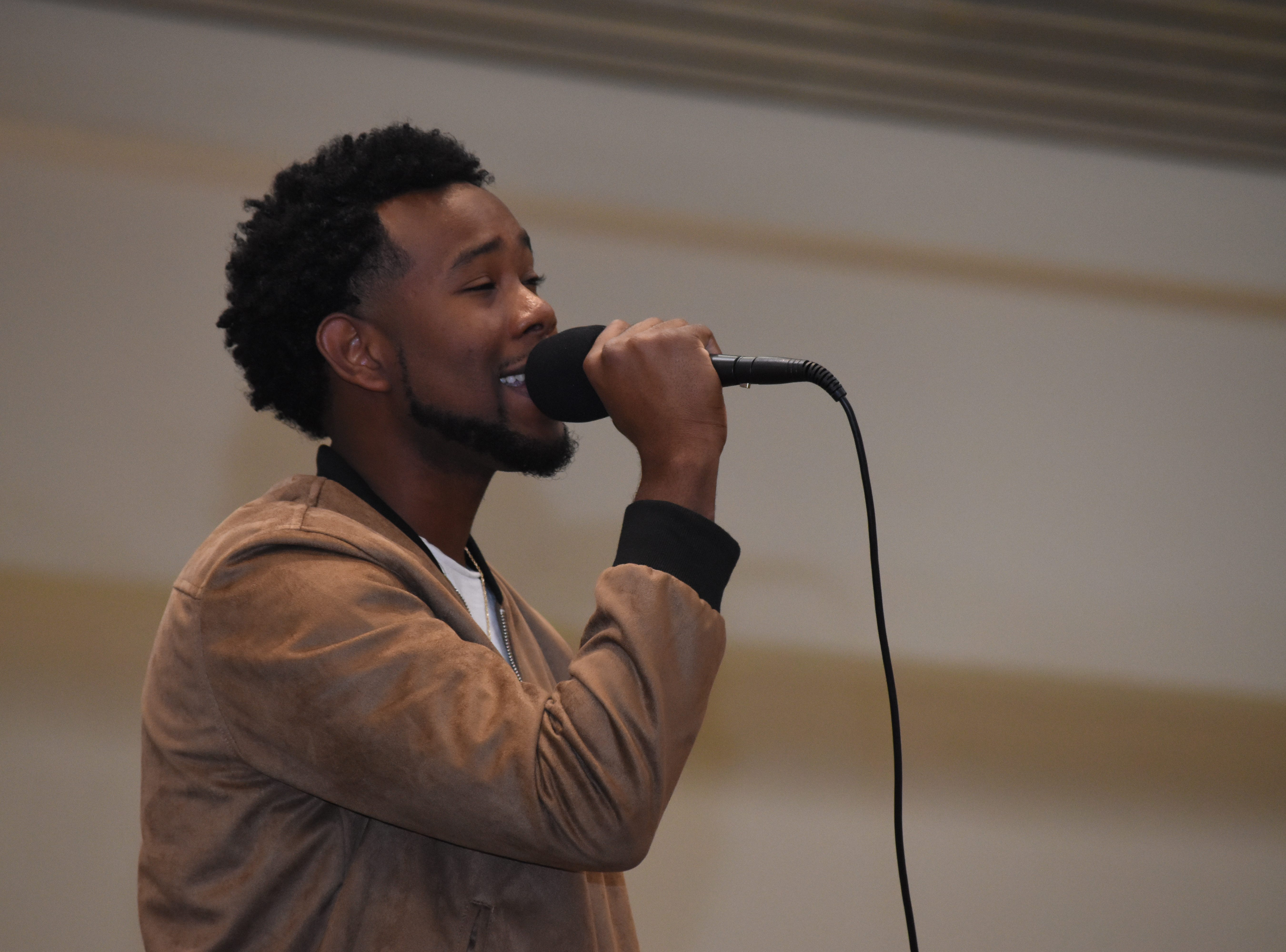 "Local R&B artist Carlton Perry performs at the Alexandria Mall Sunday, Dec. 23, 2018 to promote his new song, ""Believe."" The video can be found on Youtube. Check out the Carlton Perry Official Fan Page on Facebook."