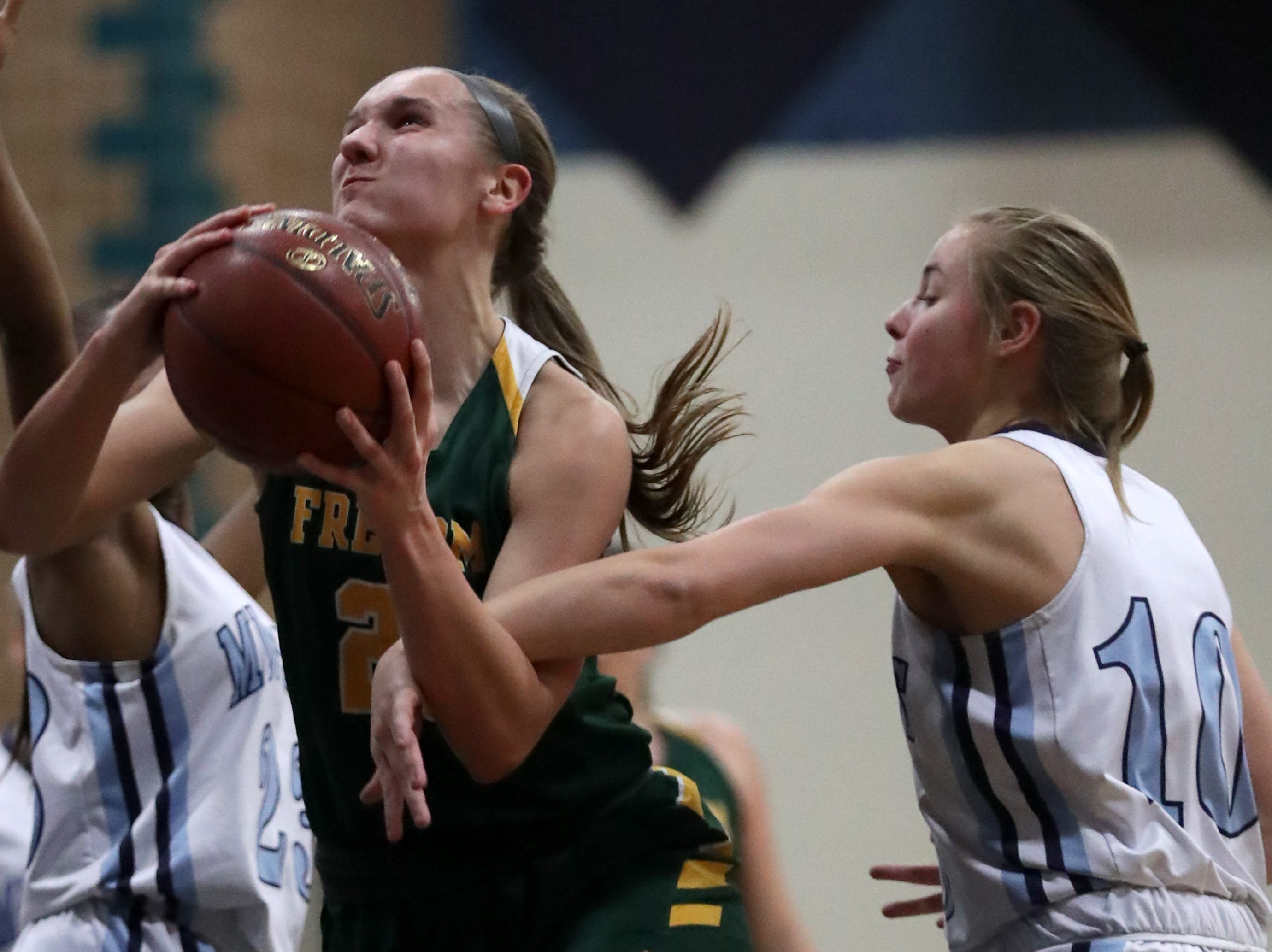Little Chute High School's #10  Marley Johnson against Freedom High School's #21Callie Genke during their North Eastern Conference girls basketball game on Friday, December 21, 2018, in Little Chute, Wis. Freedom beat Little Chute 56 to 42.Wm. Glasheen/USA TODAY NETWORK-Wisconsin.