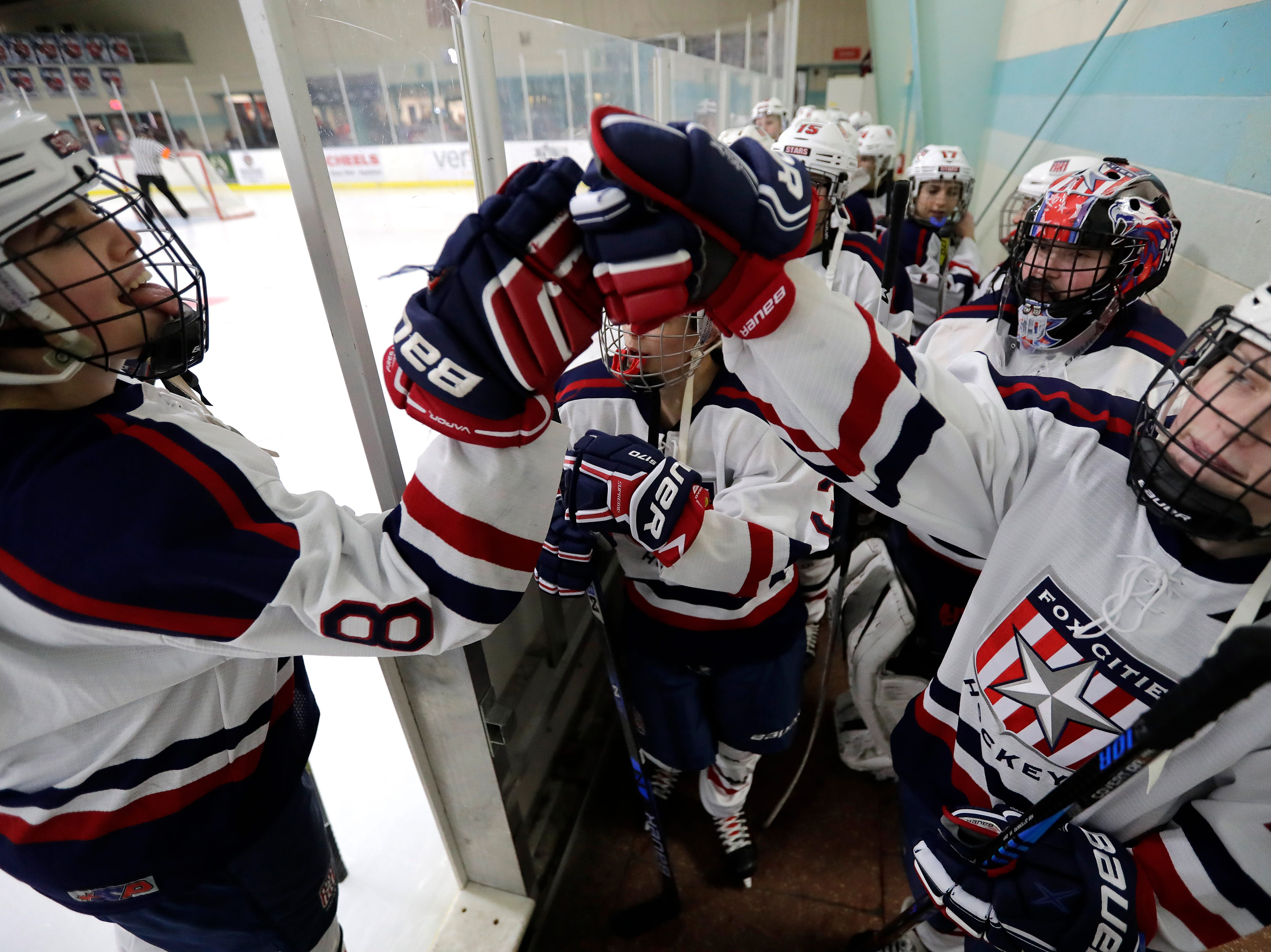 Fox Cities Stars' Victoria Nelson (8) and Annika Horman (12) fist bump as they take to the ice against Wisconsin Valley Union during their girls hockey game Tuesday, December 18, 2018, at Tri-County Ice Arena in Fox Crossing, Wis. Dan Powers/USA TODAY NETWORK-Wisconsin