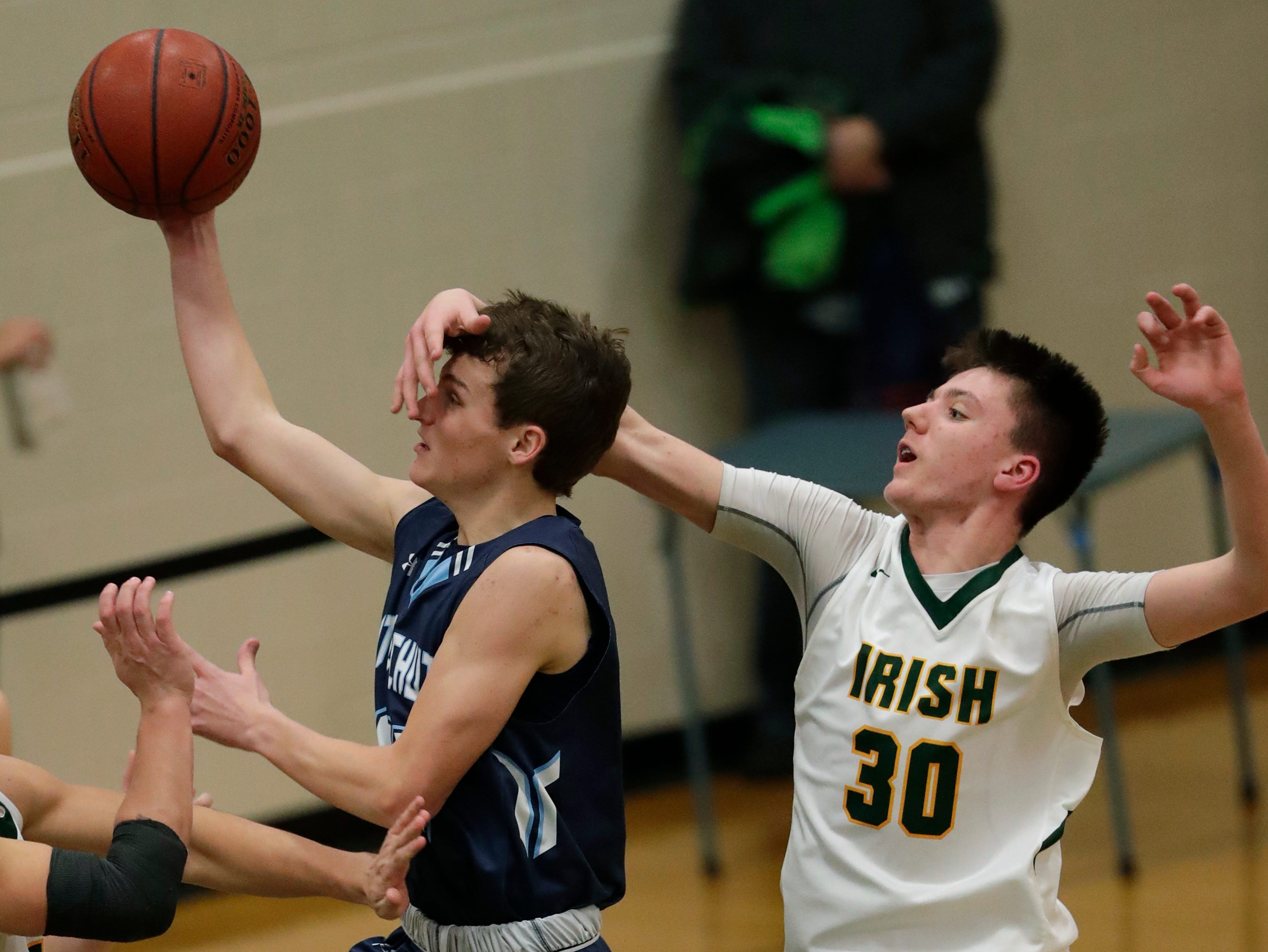 Little Chute High School's Logan Plate (14) puts up a shot against Freedom High School's Landon VanCalster (30) during their boys basketball game Thursday, December 20, 2018, in Freedom, Wis. Dan Powers/USA TODAY NETWORK-Wisconsin